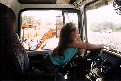 Carroll's daughter Skye, at the wheel of the boom truck.