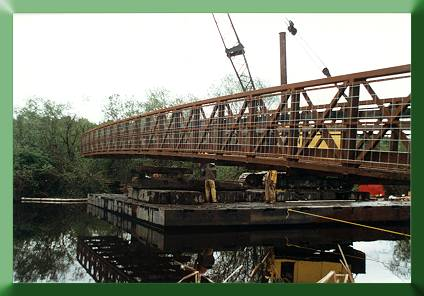 Assembling two halves of Continental Bridge with crane (on barge).