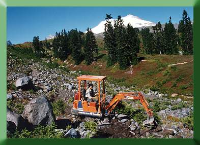 Carroll Vogel excavating with Kubota.